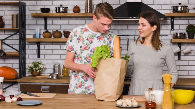 Couple ready to cook together in kitchen Free Photo