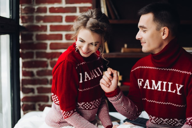 Couple in red sweaters having fun together Premium Photo