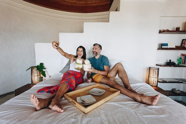 Couple relaxing on the bed Premium Photo