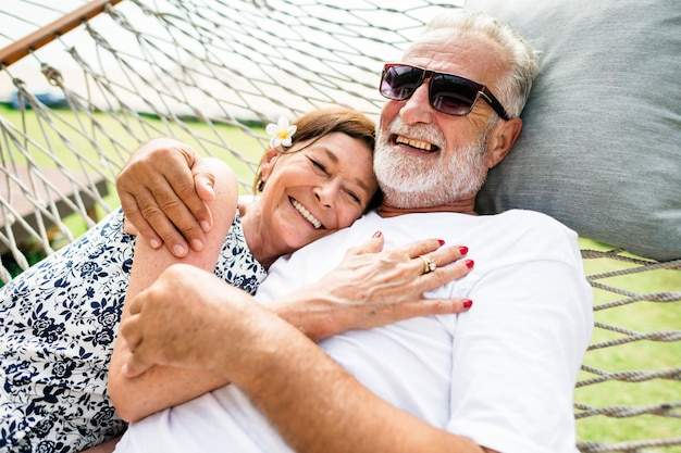 Couple relaxing on a hammock Premium Photo