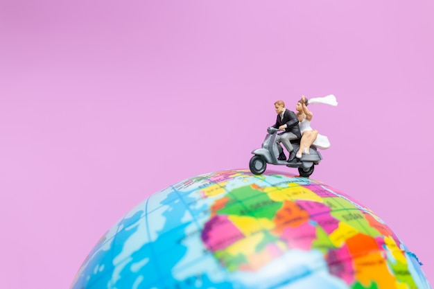 Couple riding the motorcycle on the globe , valentines concept Premium Photo