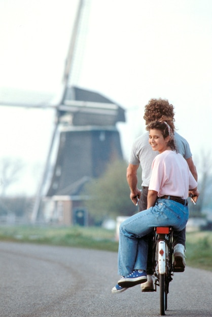Couple riding together on bicycle, holland Premium Photo