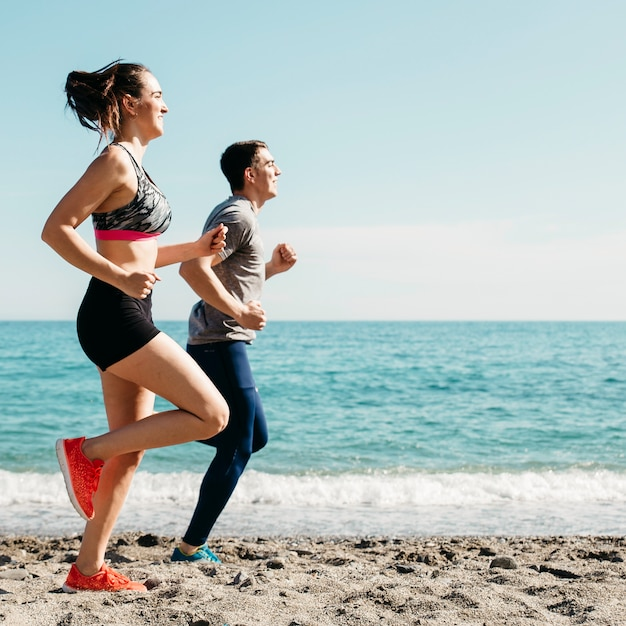 Couple running at the beach Free Photo