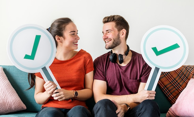 Couple showing yes sign icon Premium Photo