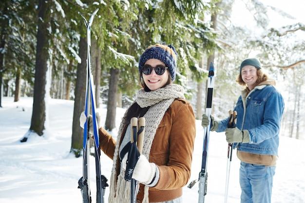 Couple skiing on resort Free Photo