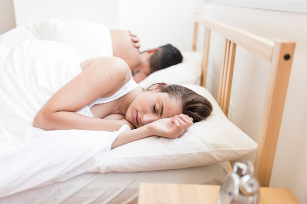 Couple sleeping on bed Free Photo