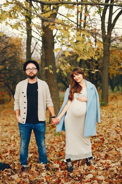 Couple spend time in a autumn park Free Photo