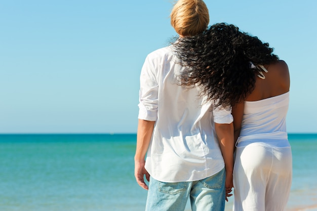 Couple on sunny beach in summer Premium Photo