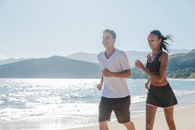 Couple sweating on the beach Free Photo