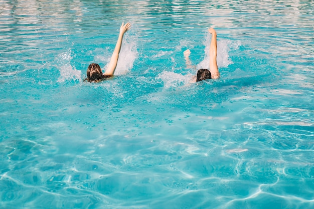Couple swimming backstroke Free Photo