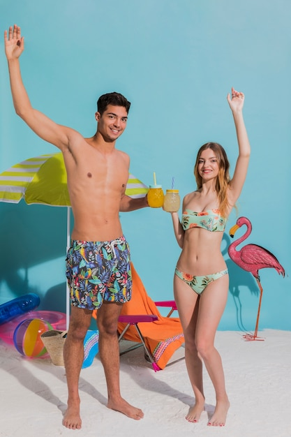 Couple in swimsuits drinking cocktails Free Photo