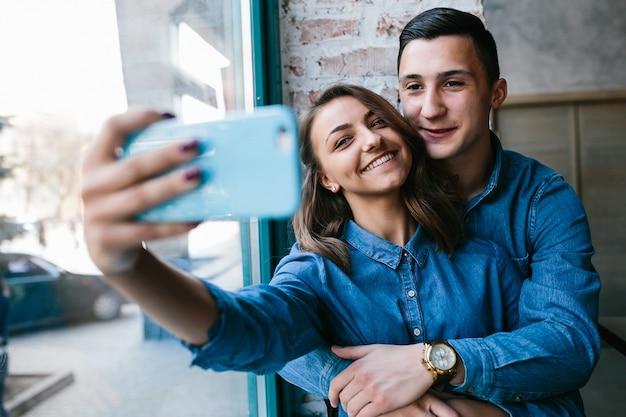 Couple taking an auto photo Free Photo