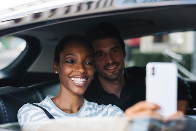 Couple taking selfie in a car Premium Photo