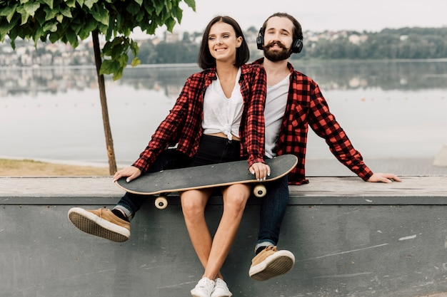 Couple together by a lake Free Photo