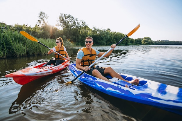 Couple together kayaking on the river Free Photo