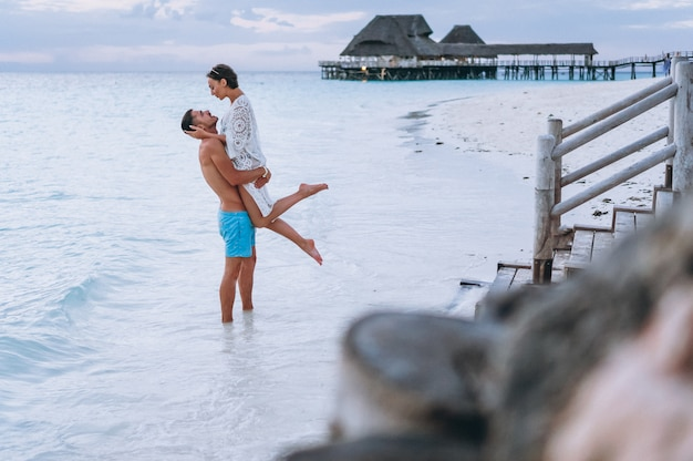 Couple together on a vacation by the ocean Free Photo