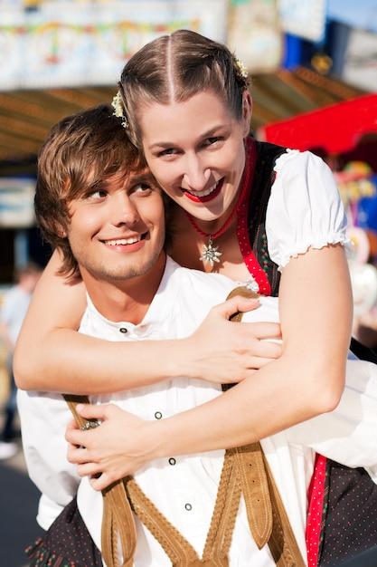 Couple in tracht on dult or oktoberfest Premium Photo