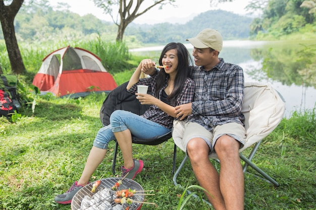 Couple traveling and spending time while camping Premium Photo