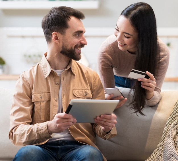 Couple trying to shop online with tablet and credit card Free Photo