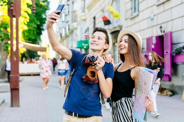 Couple on vacation taking a selfie Free Photo