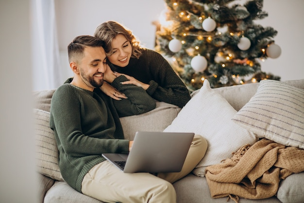 Couple on video call with laptop computer on christmas day Free Photo