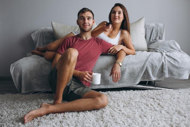 Couple at wathcing tv Free Photo