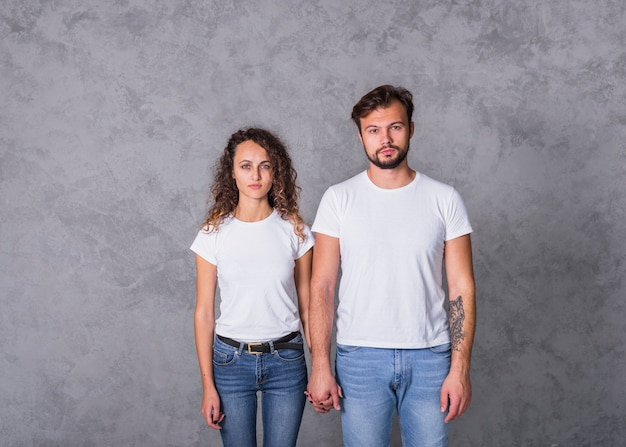 Couple in white holding hands Free Photo