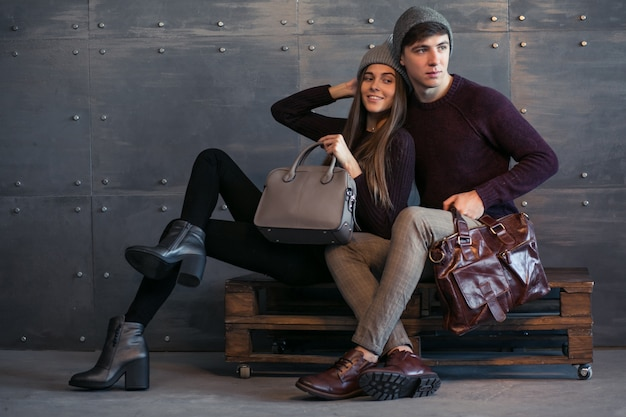 Couple in winter cloths in studio Free Photo