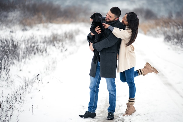 Couple in winter in the street with dog Free Photo