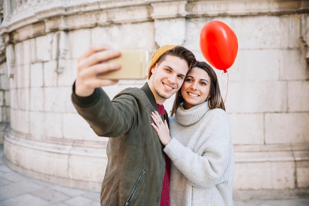 Couple with balloon taking selfie Free Photo