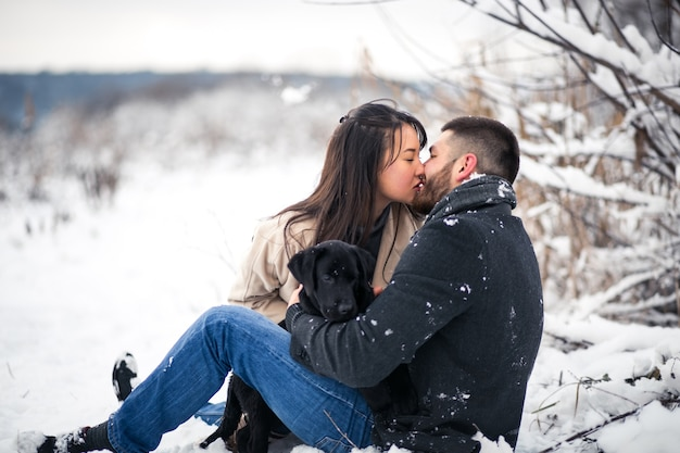 Couple with dog in winter Free Photo