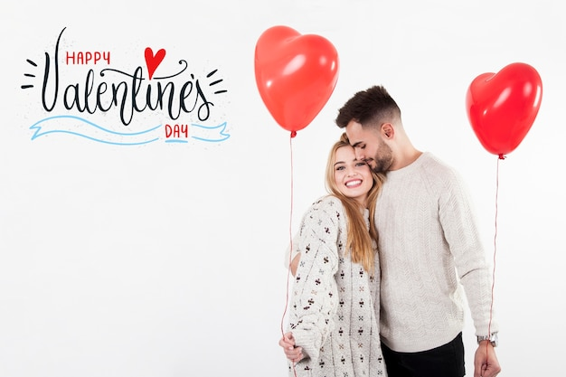 Couple with heart  ballons on valentines day Free Photo