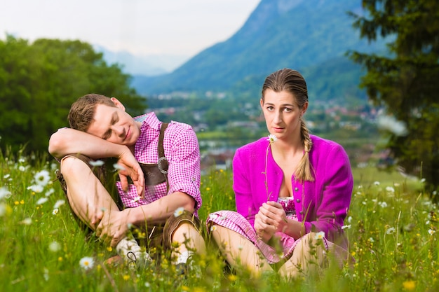 Couple with issues in alpine meadow Premium Photo