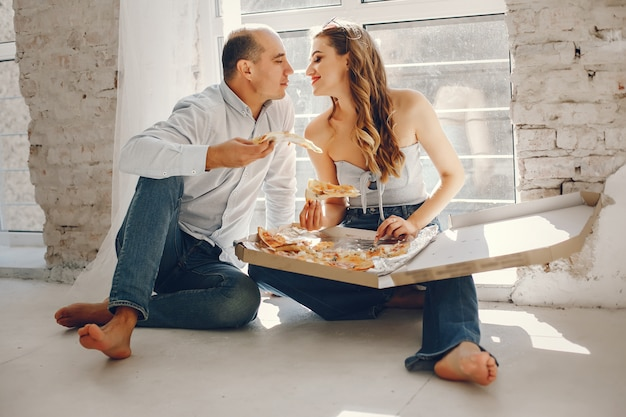 Couple with pizza Free Photo