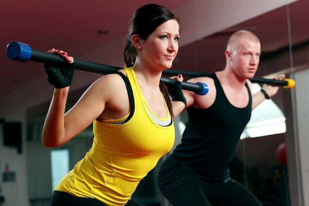 Couple working out in a fitness gym Free Photo