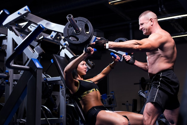 Couple working out at a gym Free Photo