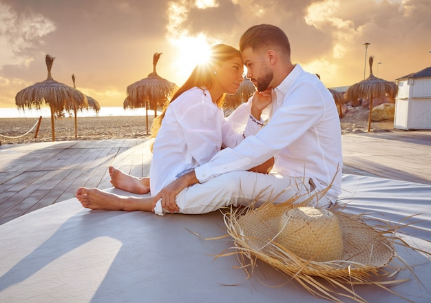 Couple young in beach vacation sunrise Premium Photo