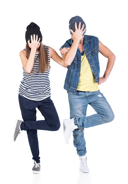 A couple of young man and woman dancing hip-hop. Premium Photo