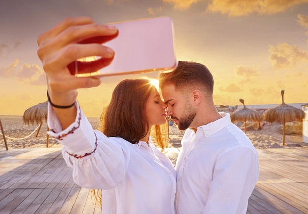 Couple young selfie photo in beach vacation Premium Photo