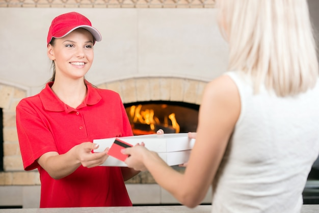 Courier delivers pizza to customer. Premium Photo