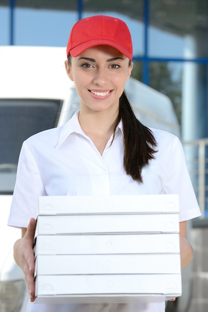 Courier delivery pizza, woman pizza delivery. Premium Photo