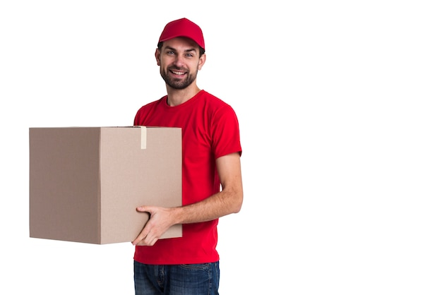 Courier man holding a big delivery box copy space Free Photo