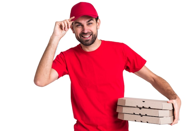 Courier man holding pile of pizza boxes and his cap Free Photo