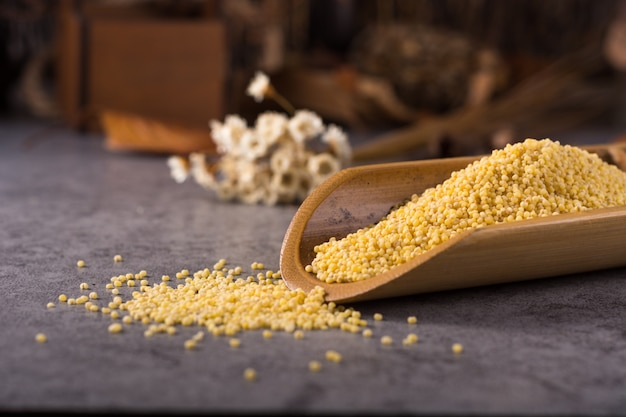 Couscous in a wooden spoon Free Photo