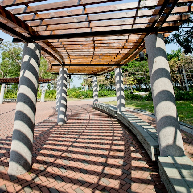 Covered walkway in the park on a sunny day Premium Photo