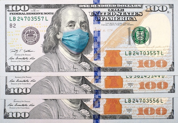 Covid-19 coronavirus in usa, 100 dollar money bill with face mask. crisis  and finance concept. | Premium Photo