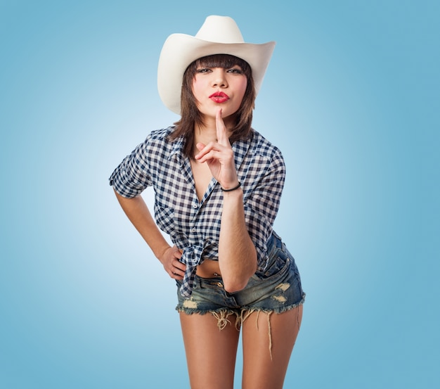 Cowgirl with an index up Free Photo