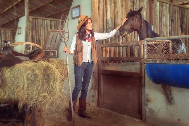 Cowgirls working at a horse farm, sakonnakhon, thailand. Premium Photo