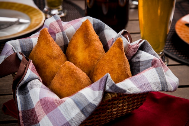 Coxinha, a brazilian snack, with a bar in the space. Free Photo