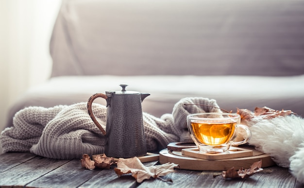 Cozy autumn still life with a cup of tea Free Photo